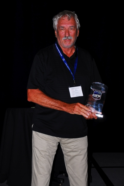John Brown with Trophy for Longest Distance Driven